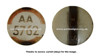 AA 5762 early issue badge with a straight fixing pin.